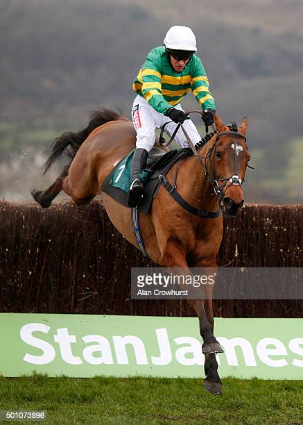 Barry Geraghty riding More Of That clear the last to win The Raymond Mould Memorial Noovices' Steeple Chase at Cheltenham racecourse on December 12...