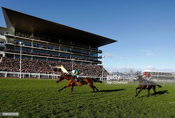 Barry Geraghty riding More Of That clear the last to win The Steel Plate And Sections Novices' Steeple Chase at Cheltenham racecourse on November 13...