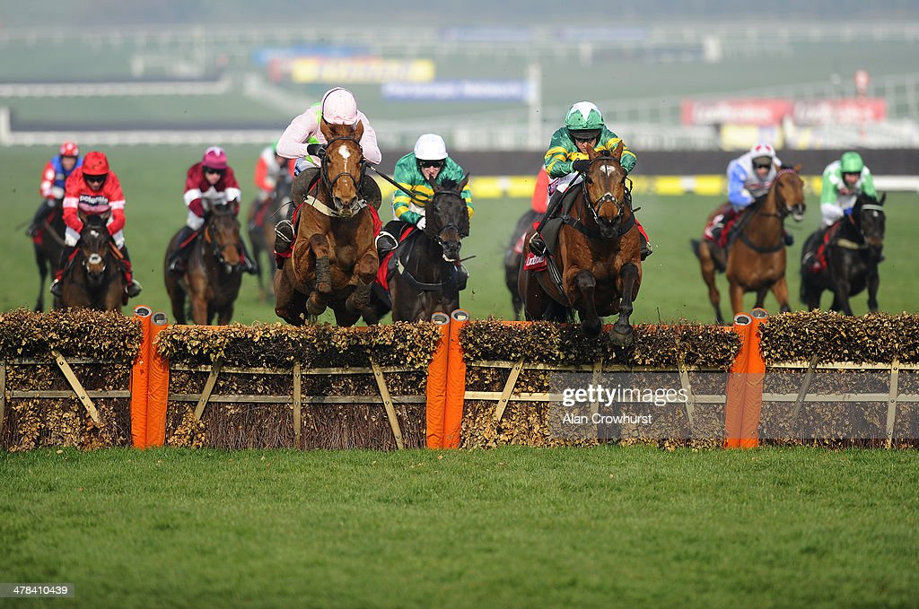 <a gi-track='captionPersonalityLinkClicked' href=/galleries/search?phrase=Barry+Geraghty&family=editorial&specificpeople=198943 ng-click='$event.stopPropagation()'>Barry Geraghty</a> riding More Of That (3R, green) clear the last to win The Ladbrokes World Hurdle Race from Annie Power (L, pink) on St Patrick's Thursday during the Cheltenham Festival at Cheltenham racecourse on March 13, 2014 in Cheltenham, England.
