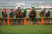 Barry Geraghty riding More Of That clear the last to win The Ladbrokes World Hurdle Race from Annie Power on St Patrick's Thursday during the...