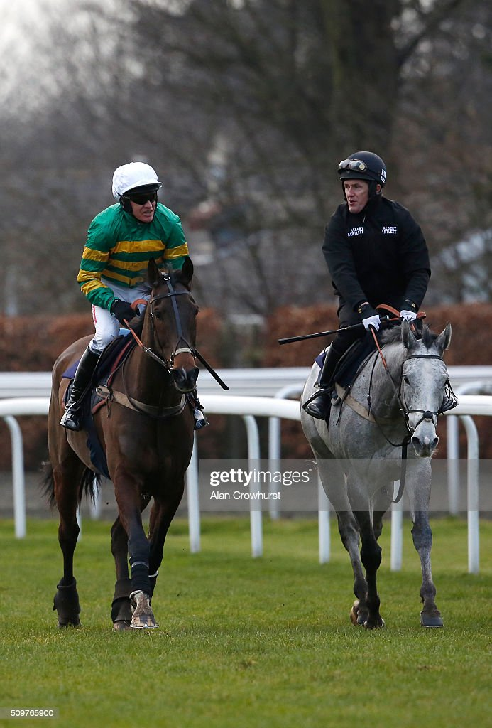<a gi-track='captionPersonalityLinkClicked' href=/galleries/search?phrase=Barry+Geraghty&family=editorial&specificpeople=198943 ng-click='$event.stopPropagation()'>Barry Geraghty</a> riding My Tent Or Yours (L) and Sir AP McCoy riding Hargam after a racecourse gallop at Kempton Park racecourse on February 12, 2016 in Sunbury, England.