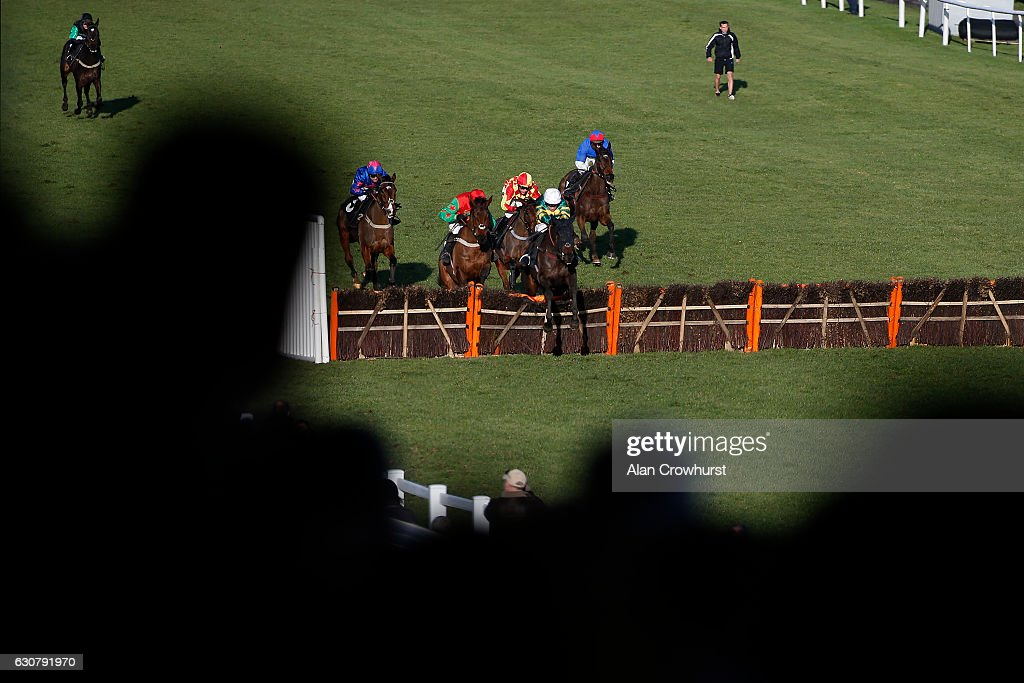 Barry Geraghty riding No Comment (C, white cap) clear the last to win The Follow At The Races On Instagram EBF 'National Hunt Novices' Hurdle Race at Plumpton racecourse on January 02, 2017 in Plumpton, England.