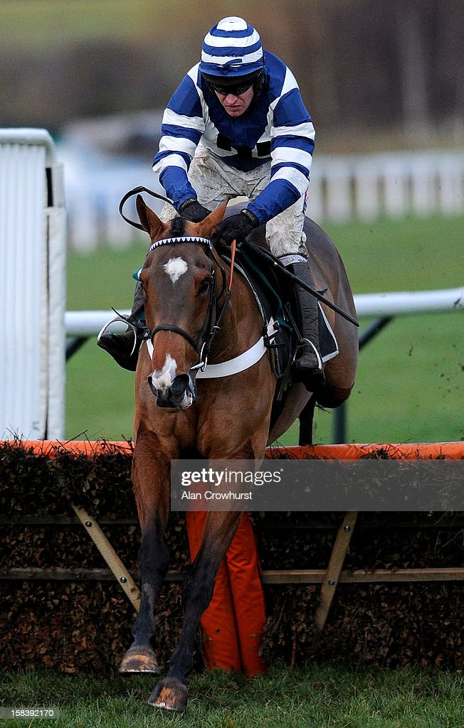 <a gi-track='captionPersonalityLinkClicked' href=/galleries/search?phrase=Barry+Geraghty&family=editorial&specificpeople=198943 ng-click='$event.stopPropagation()'>Barry Geraghty</a> riding Oscar Whisky clear the last to win the Osborne House Relkeel Hurdle Race at Cheltenham racecourse on December 15, 2012 in Cheltenham, England.