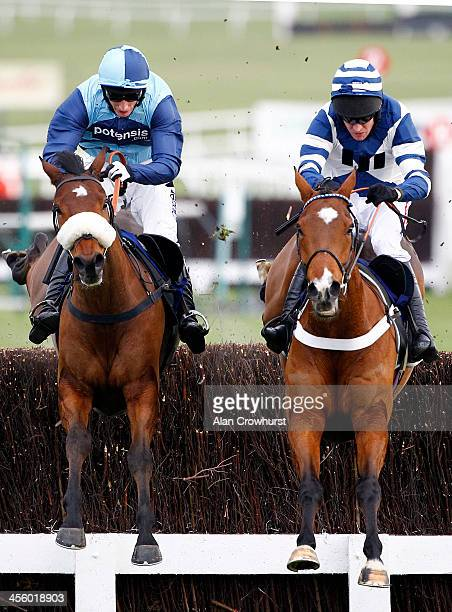 Barry Geraghty riding Oscar Whisky clear the last to win The Ryman Stationary Cheltenham Business Club Novices' Steeple Chase from Daryl Jacob riding...