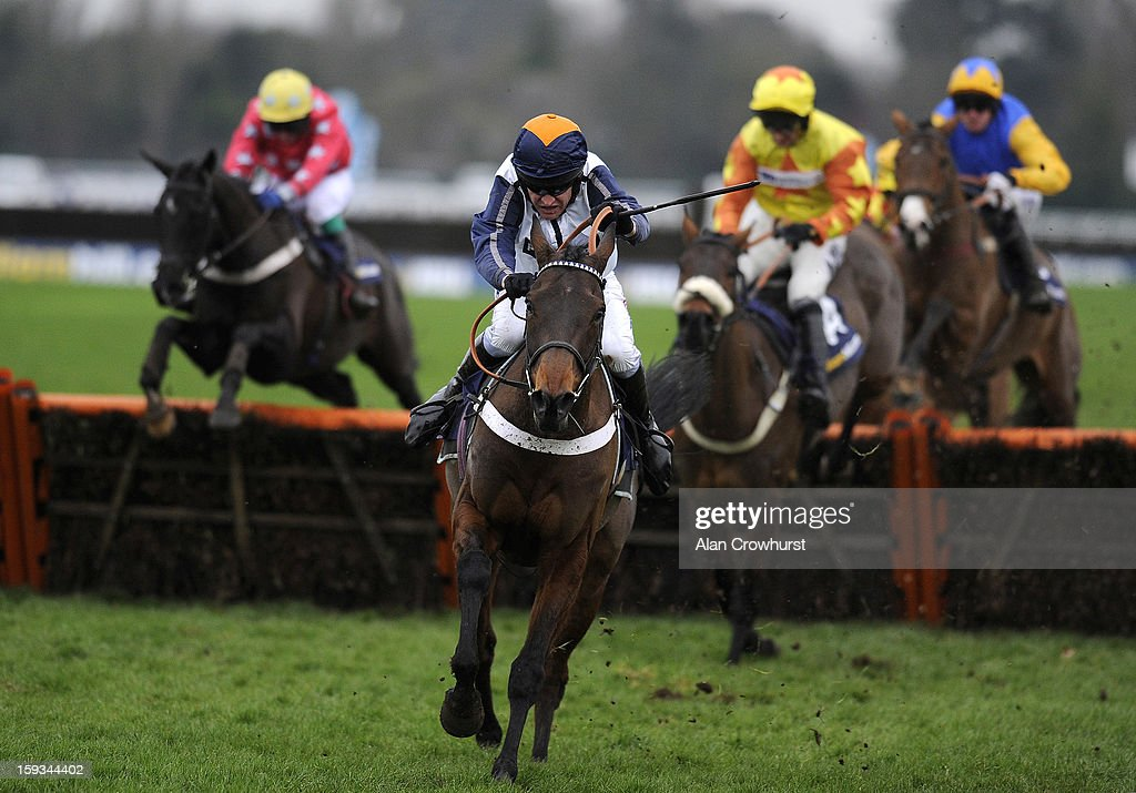 Barry Geraghty riding Oscara Dara clear the last to win The William Hill Lanzarote Hurdle Race at Kempton racecourse on January 12, 2013 in Sunbury, England.