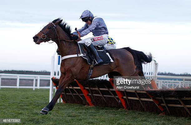 Barry Geraghty riding Out Sam clear the last to win The EBF Stallions 'National Hunt' Novices' Hurdle Race at Ascot racecourse on January 17 2015 in...