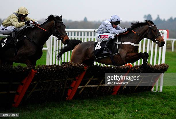 Barry Geraghty riding Out Sam clear the last to win The Inkerman London Novices' Hurdle Race at Newbury racecourse on November 28 2014 in Newbury...