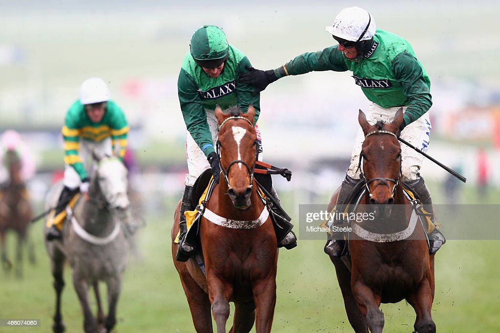Barry Geraghty (L) riding Peace and Co is congratulated by Daryl Jacob (R) riding Top Notch after victory in the JCB Triumph Hurdle race during day four of the Cheltenham Festival at Cheltenham Racecourse on March 13, 2015 in Cheltenham, England.
