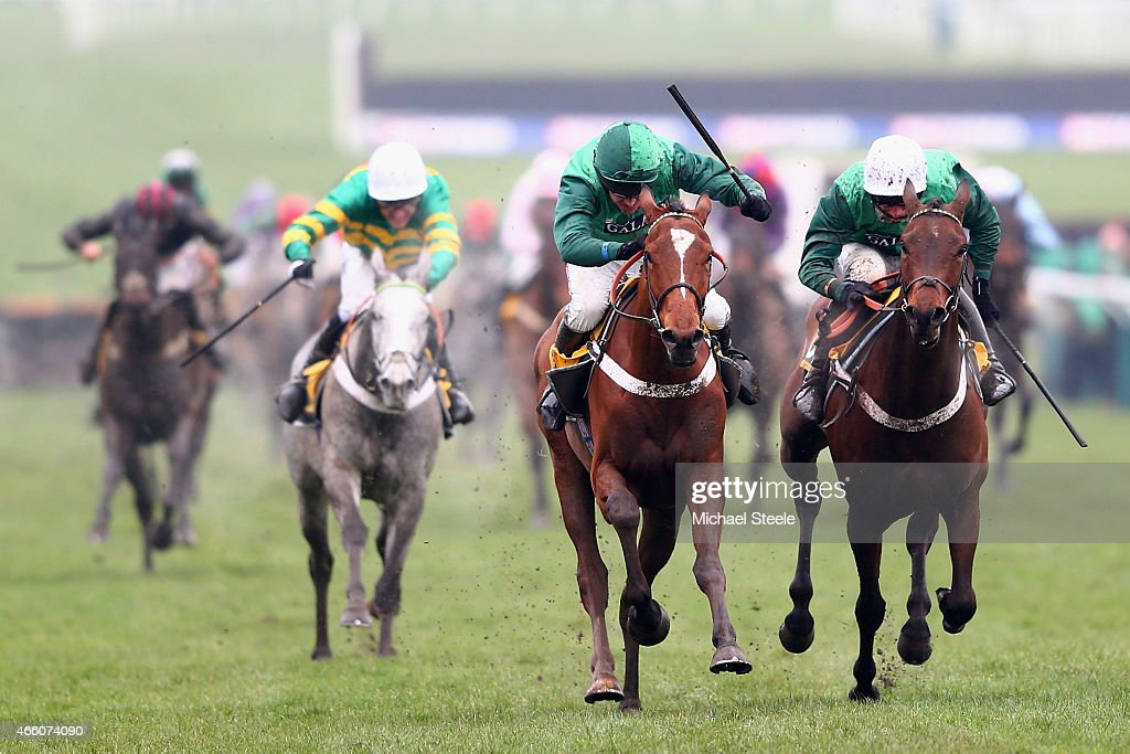 Barry Geraghty riding Peace and Co on his way to victory from Daryl Jacob riding Top Notch in the JCB Triumph Hurdle race during day four of the...