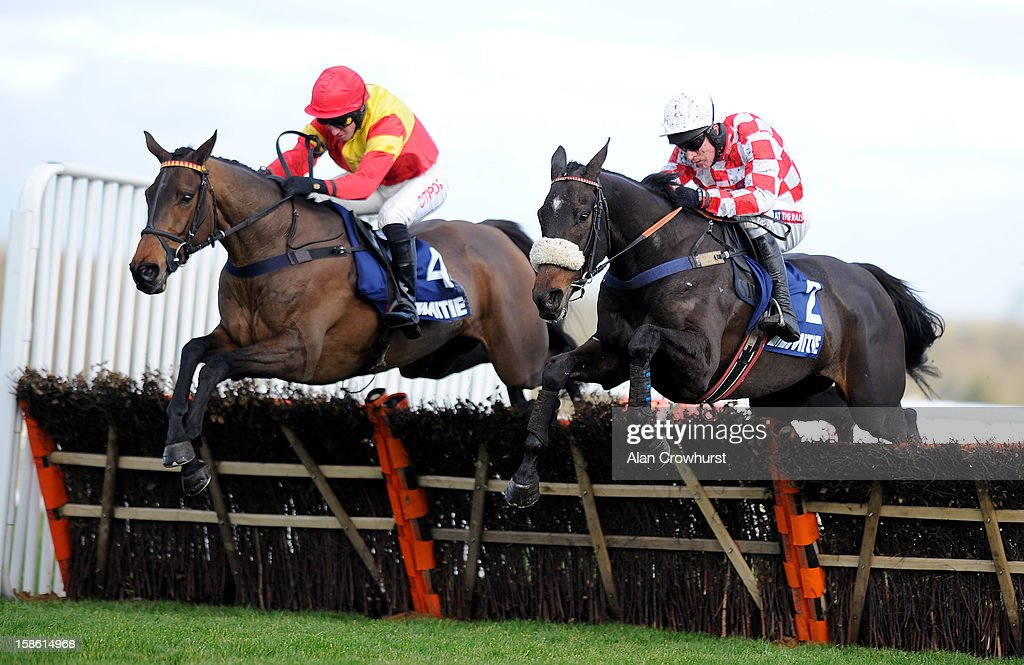 <a gi-track='captionPersonalityLinkClicked' href=/galleries/search?phrase=Barry+Geraghty&family=editorial&specificpeople=198943 ng-click='$event.stopPropagation()'>Barry Geraghty</a> riding Puffin Billy (R) clear the last to win The Mitie Kennel Gate Novices' Hurdle Race from Up To Something (L) at Ascot racecourse on December 21, 2012 in Ascot, England.