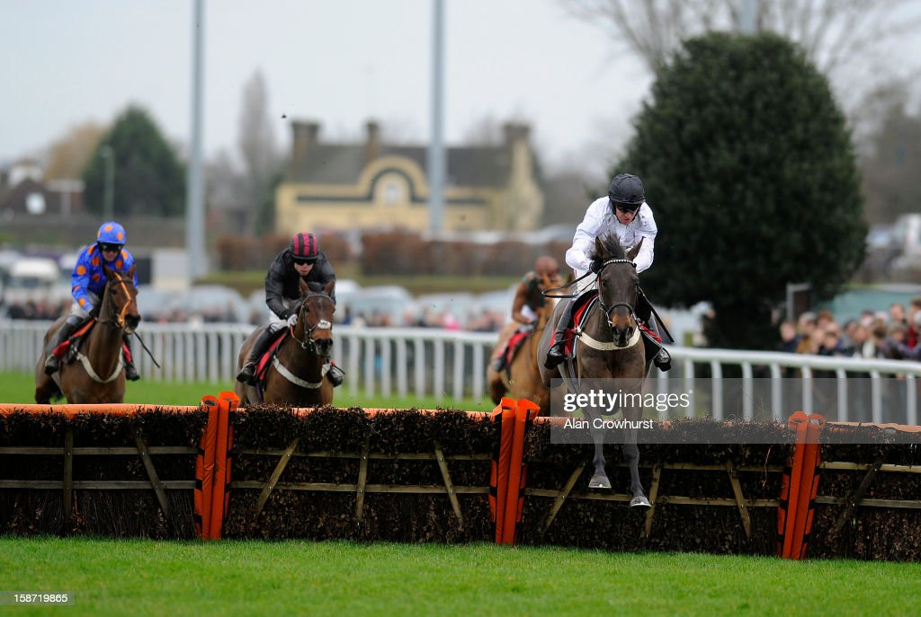 <a gi-track='captionPersonalityLinkClicked' href=/galleries/search?phrase=Barry+Geraghty&family=editorial&specificpeople=198943 ng-click='$event.stopPropagation()'>Barry Geraghty</a> riding River Maigue clear the last to win The William Hill - No. 1 Download Betting App Novices' Hurdle Race at Kempton racecourse on December 26, 2012 in Sunbury, England.