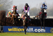Barry Geraghty riding Riverside Theatre clear the last to win The Betfred Peterborough Steeple Chase from Champion Court at Huntingdon racecourse on...