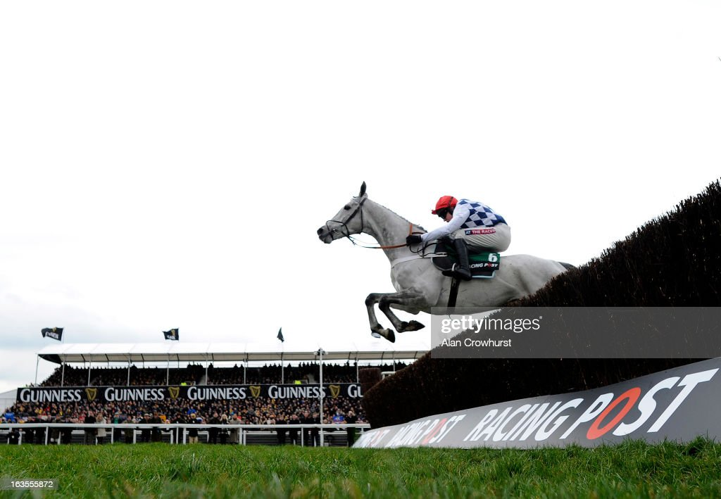 <a gi-track='captionPersonalityLinkClicked' href=/galleries/search?phrase=Barry+Geraghty&family=editorial&specificpeople=198943 ng-click='$event.stopPropagation()'>Barry Geraghty</a> riding Simonsig clear the last to win The Racing Post Arkle Challenge Trophy Steeple Chase during Champion Day at Cheltenham racecourse on March 12, 2013 in Cheltenham, England.