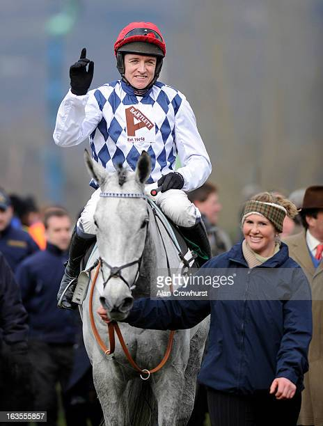 Barry Geraghty riding Simonsig win The Racing Post Arkle Challenge Trophy Steeple Chase during Champion Day at Cheltenham racecourse on March 12 2013...