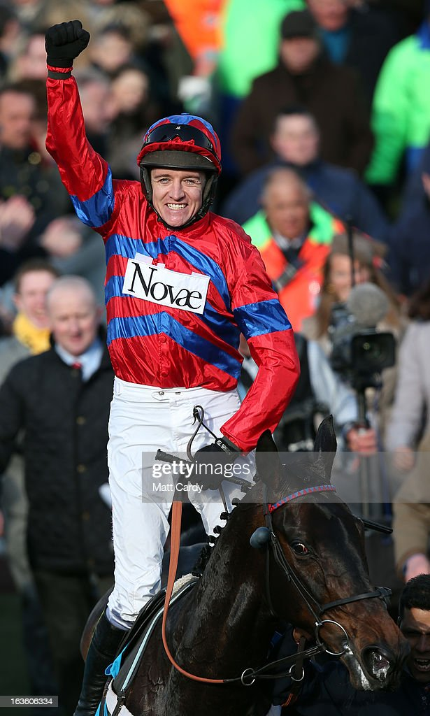 Barry Geraghty riding Sprinter Sacre celebrates winning The Sporting Bet Queen Mother Champion Steeple Chase during Ladies Day at Cheltenham Racecourse on the second day of the Cheltenham Festival 2013 on March 13, 2013 in Cheltenham, England. Approximately 200,000 racing enthusiasts are expected at the four-day festival, which opened yesterday and is seen by many as the highlight of the jump racing calendar.