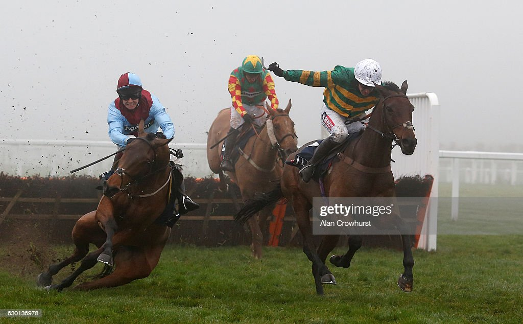 Barry Geraghty riding Unowhatimeanharry (R) clear the last to win The JLT Long Walk Hurdle Race as Richard Johnson riding Ballyoptic fall at Ascot Racecourse on December 17, 2016 in Ascot, England.