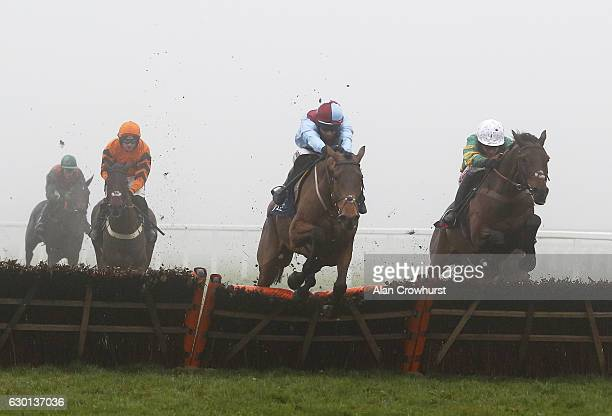 Barry Geraghty riding Unowhatimeanharry clear the last to win The JLT Long Walk Hurdle Race as Richard Johnson riding Ballyoptic fall at Ascot...