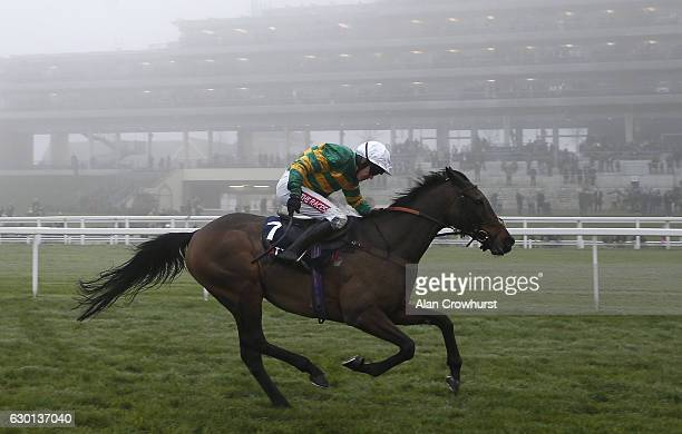 Barry Geraghty riding Unowhatimeanharry clear the last to win The JLT Long Walk Hurdle Race at Ascot Racecourse on December 17 2016 in Ascot England