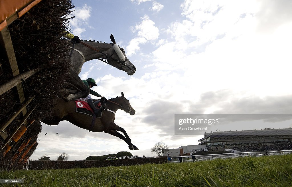<a gi-track='captionPersonalityLinkClicked' href=/galleries/search?phrase=Barry+Geraghty&family=editorial&specificpeople=198943 ng-click='$event.stopPropagation()'>Barry Geraghty</a> riding Utopie Des Bordes clear the last to win The Jane Seymour Mares' Hurdle Race at Sandown racecourse on February 15, 2013 in Esher, England.