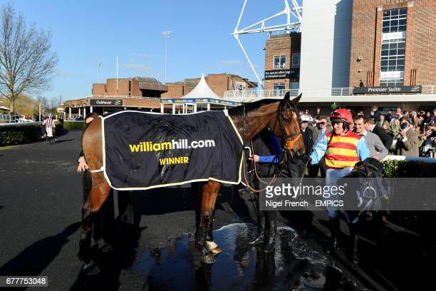 Barry Geraghty with Hunt Ball in the winners enclosure after winning The William Hill App 25 SignUp Bonus Handicap Steeple Chase