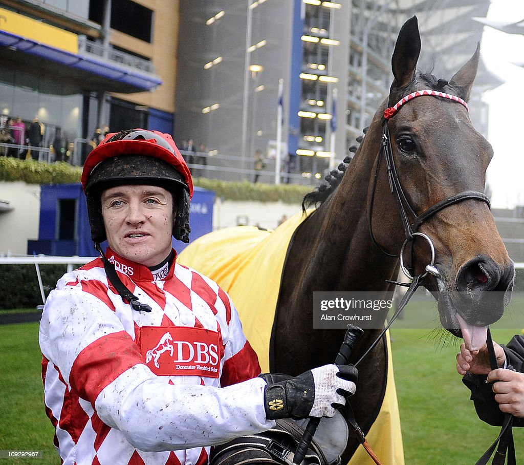 <a gi-track='captionPersonalityLinkClicked' href=/galleries/search?phrase=Barry+Geraghty&family=editorial&specificpeople=198943 ng-click='$event.stopPropagation()'>Barry Geraghty</a> with Riverside Theatre after winning The Betfair Ascot Steeple Chase at Ascot racecourse on February 19, 2011 in Ascot, England