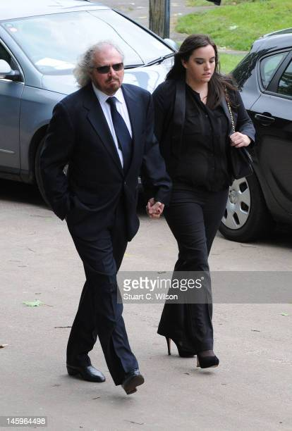 Barry Gibb and Ali Gibb attend the funeral of Robin Gibb at Priest End Thame on June 8 2012 in Oxford England