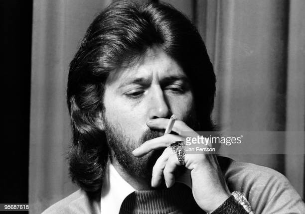 Barry Gibb from The Bee Gees posed smoking at a Press Conference in Copenhagen Denmark in 1975