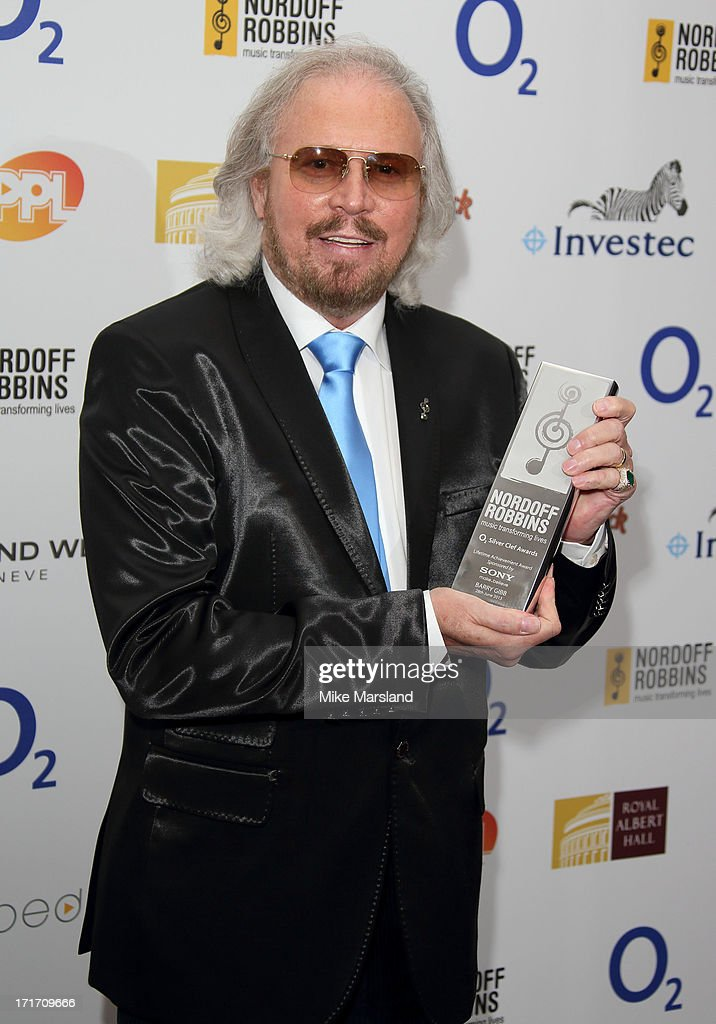 <a gi-track='captionPersonalityLinkClicked' href=/galleries/search?phrase=Barry+Gibb&family=editorial&specificpeople=208122 ng-click='$event.stopPropagation()'>Barry Gibb</a> holds his Lifetime Achievement Award as he attends the Nordoff Robbins Silver Clef Awards at London Hilton on June 28, 2013 in London, England.