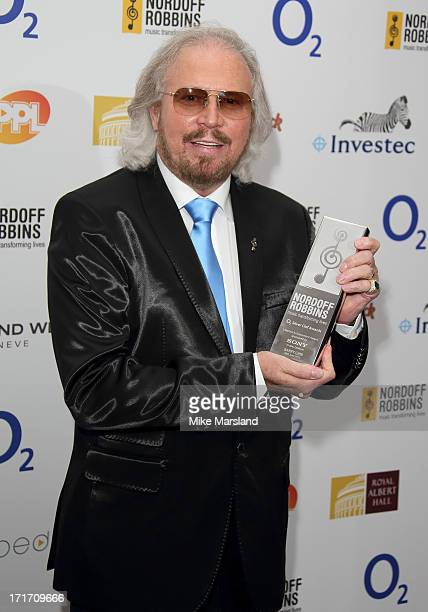 Barry Gibb holds his Lifetime Achievement Award as he attends the Nordoff Robbins Silver Clef Awards at London Hilton on June 28 2013 in London...