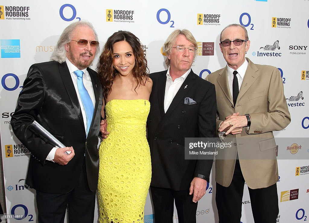 Barry Gibb, Myleene Klass, Francis Rossi and Rick Parfitt of Status Quo attend the Nordoff Robbins Silver Clef Awards at London Hilton on June 28, 2013 in London, England.