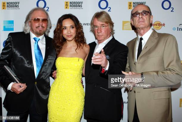 Barry Gibb Myleene Klass Rick Parfitt and Francis Rossi attend Nordoff Robbins Silver Clef Awards at Hilton Hotel in London