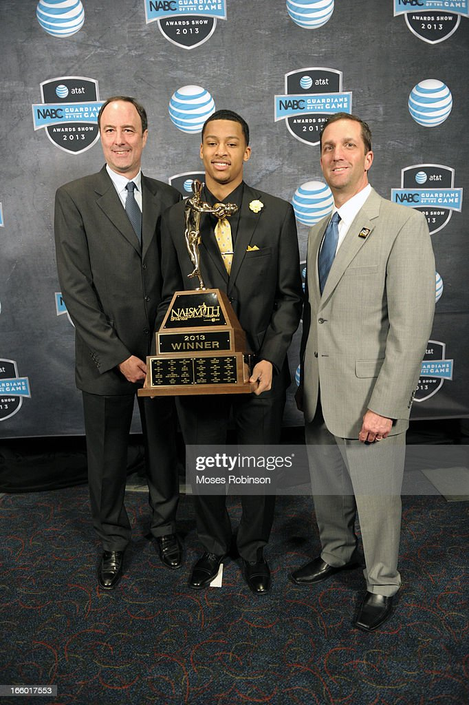 Barry Goheen, Trey Burke and Eric Oberman pose with the 2013 Naismith Trophy at the NABC Guardians of the Game Awarding of the Naismith Trophy Presented by AT&T at Georgia World Congress Center on April 7, 2013 in Atlanta, Georgia.