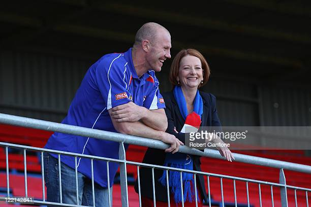 Barry Hall and Prime Minister Julia Gillard pose for the media prior to the official launch of Hall's new book 'Pulling No Punches' at Whitten Oval...