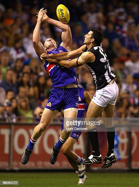 Barry Hall of the Bulldogs competes for a mark with Simon Prestigiacomo of the Magpies during the round one AFL match between the Western Bulldogs...