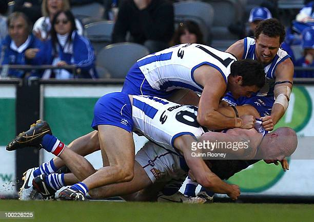 Barry Hall of the Bulldogs gets Scott Thompson of the Kangaroos in a head lock during the round nine AFL match between the North Melbourne Kangaroos...