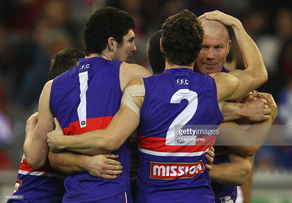 Barry Hall of the Bulldogs is congratulated by team-mates after kicking a goal during the AFL First Semi Final match between the Western Bulldogs and the Sydney Swans at Melbourne Cricket Ground on September 11, 2010 in Melbourne, Australia.