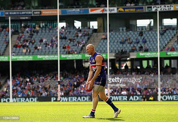 Barry Hall of the Bulldogs lines up a shot on goal during the round 24 AFL match between the Western Bulldogs and the Fremantle Dockers at Etihad...