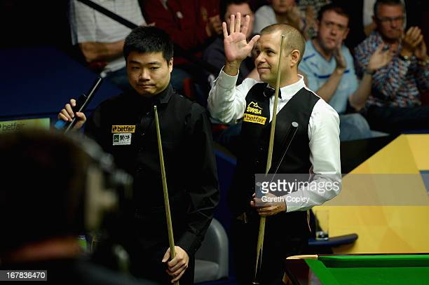 Barry Hawkins celebrates beating Ding Junhui during their Quarter Final match in the Betfair World Snooker Championship at the Crucible Theatre on...