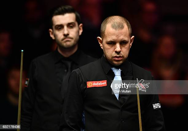 Barry Hawkins of England and Mark Selby of England look on during their quarter final match on day six of the Dafabet Masters at Alexandra Palace on...