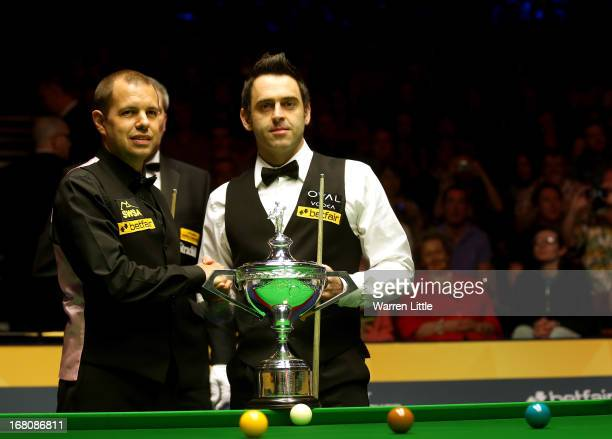 Barry Hawkins of England and Ronnie O'Sullivan of England shake hands ahead of the final of the Betfair World Snooker Championship at the Crucible...