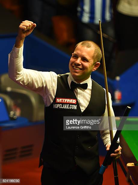 Barry Hawkins of England celebrates victory in his second round match against Ronnie O'Sullivan of England on day ten of the World Snooker...