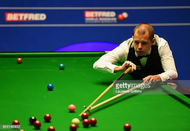 Barry Hawkins of England in action during his second round match against Ronnie O'Sullivan of England on day ten of the World Snooker Championship at...
