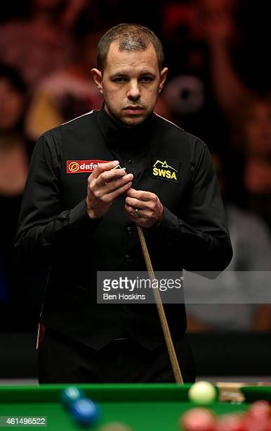Barry Hawkins of England looks on during his first round match against Ali Carter of England on day three of The Dafabet Masters at Alexandra Palace...