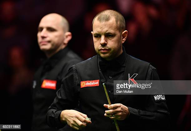Barry Hawkins of England looks on during his semi final match against Joe Perry of England on day seven of the Dafabet Masters at Alexandra Palace on...