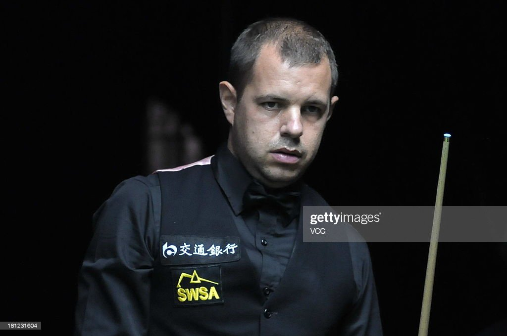 Barry Hawkins of England looks on in the match against Ryan Day of Wales on day four of the 2013 World Snooker Shanghai Master at Shanghai Grand Stage on September 19, 2013 in Shanghai, China.