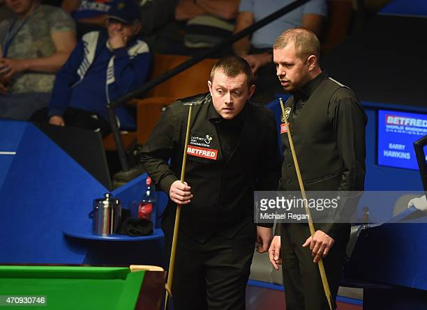 Barry Hawkins of England looks on with Mark Allen of Northern Ireland during day seven of the 2015 Betfred World Snooker Championship at Crucible...