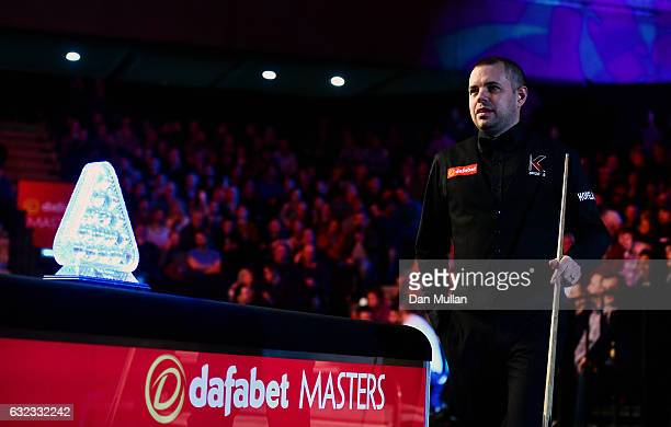 Barry Hawkins of England makes his way to the table for his semi final match against Joe Perry of England on day seven of the Dafabet Masters at...
