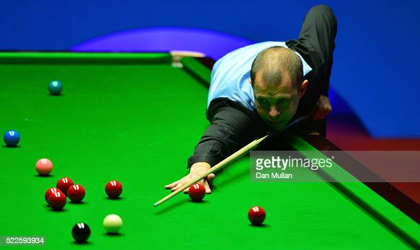 Barry Hawkins of England plays a shot during his first round match against Zhang Anda of China on day 5 of the World Snooker Championship at The...