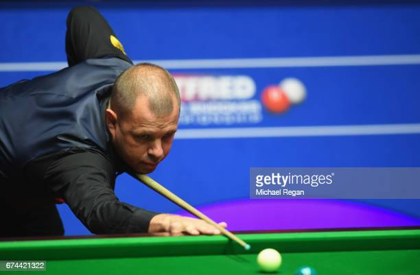 Barry Hawkins of England plays a shot during the semifinal match against John Higgins of Scotland on day fourteen of Betfred World Championship 2017...