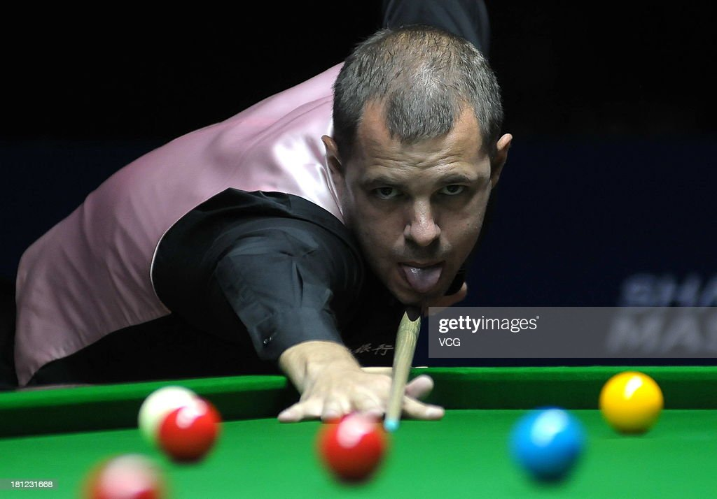 Barry Hawkins of England plays a shot in the match against Ryan Day of Wales on day four of the 2013 World Snooker Shanghai Master at Shanghai Grand Stage on September 19, 2013 in Shanghai, China.